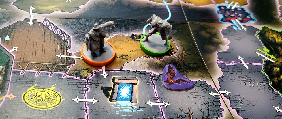 two character pieces with colored based standing on a board game surface.