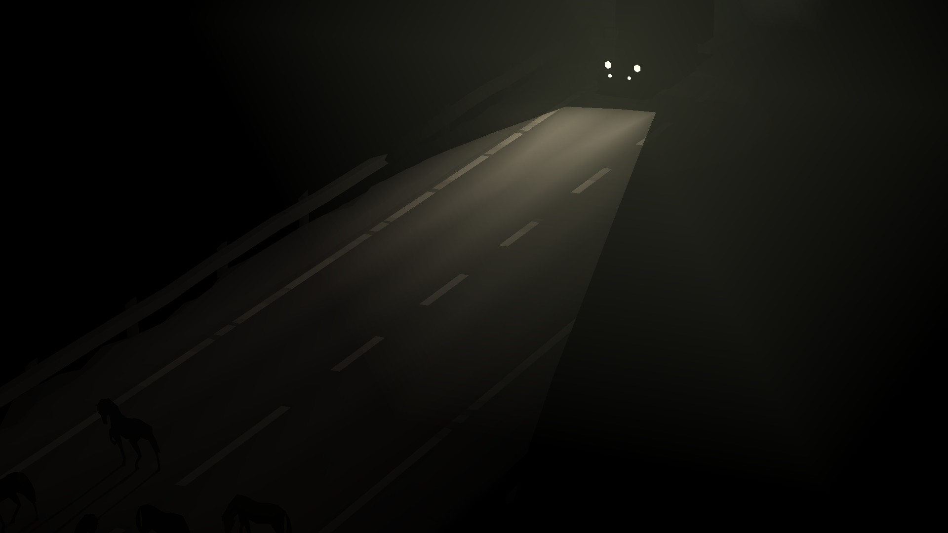 The lights of a truck reveal an empty highway.