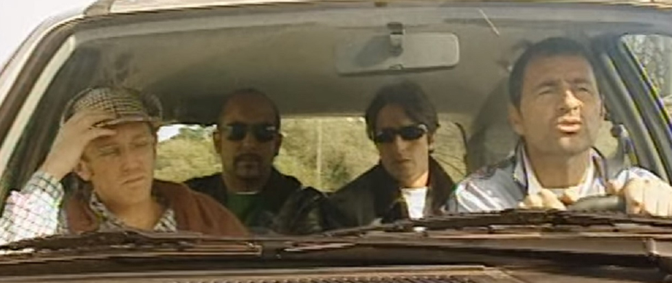 Four shady guys in a car together.