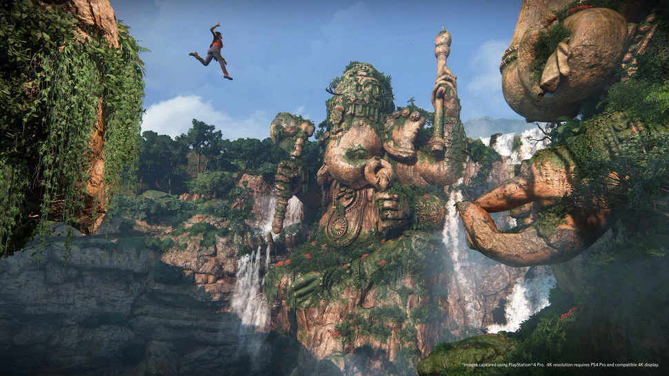 A figure leaps through the air in a canyon filled with massive elephant shaped carvings.