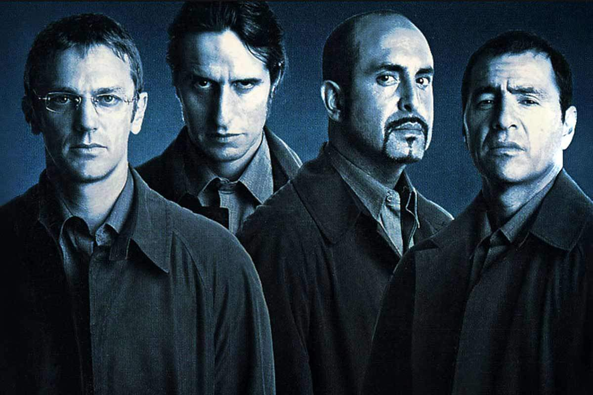 Four shady men being shady in blue tones.