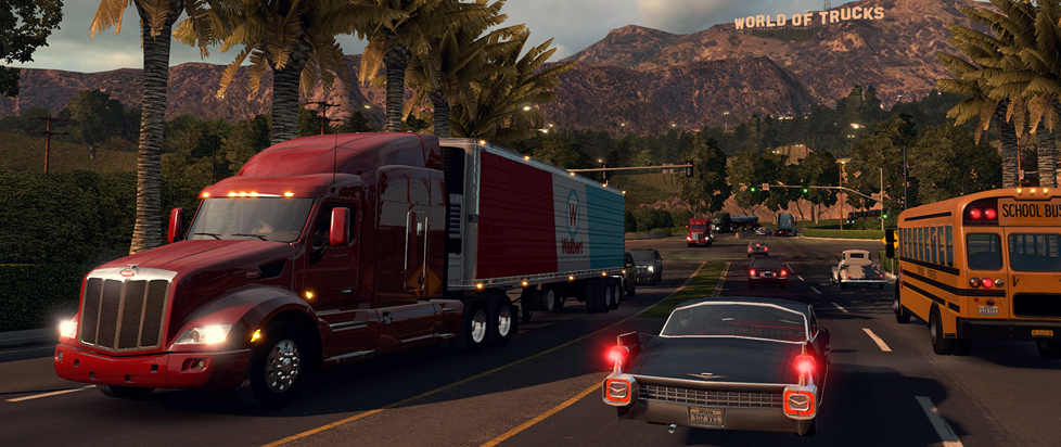 """A screenshot of the game American Truck Simulator showing a Truck riding down a California highway with a hot rod in the opposite direction. In the distance, in the form of a """"hollywood sign"""" you can see """"World of Trucks."""""""