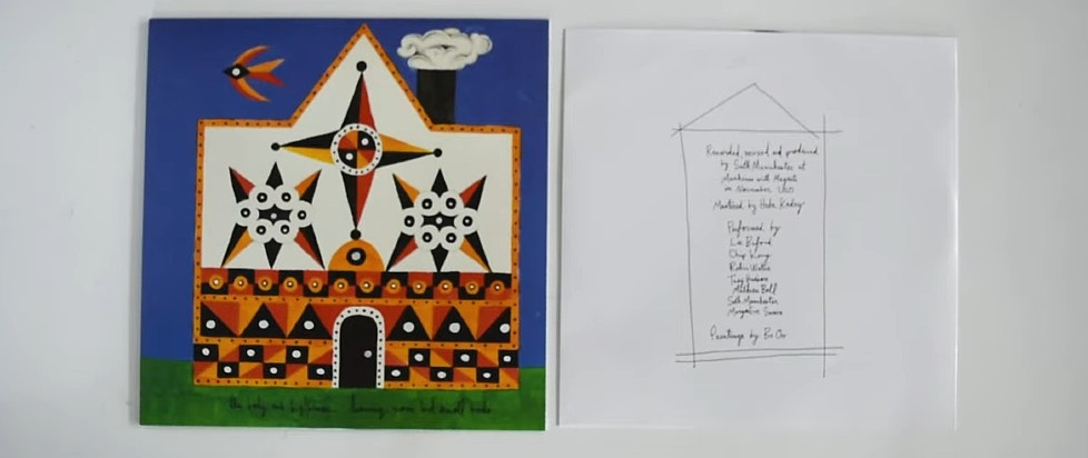 The record for The Body and BIG|BRAVE's Leaving None but Small Birds, accompanied by its insert. The album art features a geometric orange and white house on green grass against a deep blue sky. The insert lists all of the album's track names within a minimalistic sketch of a house.