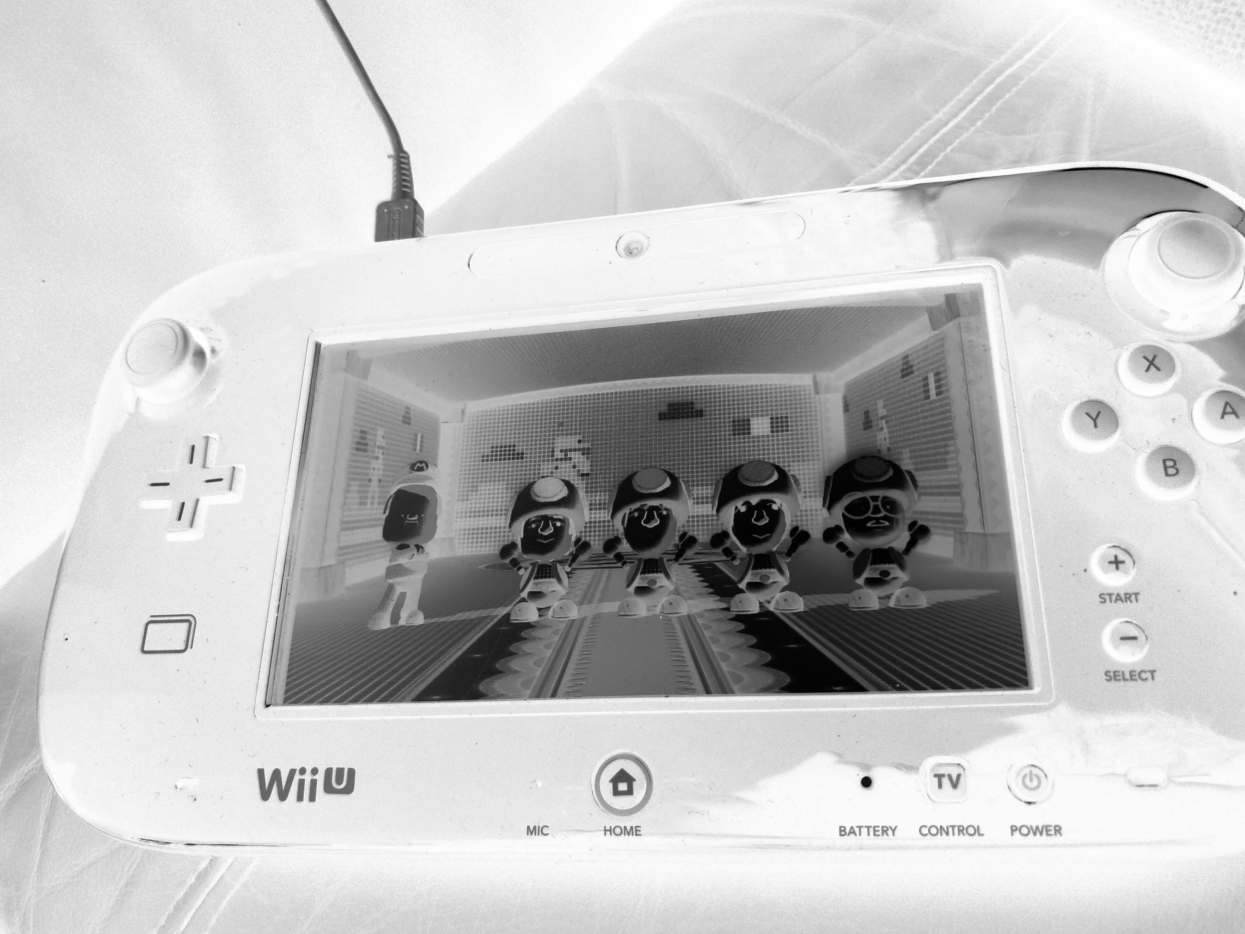 An infared image of a Wii U screen showing a collection of Mii toads in a room.